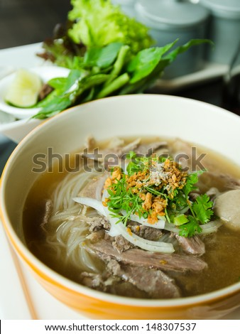 Front of Pho Lao style noodle soup with vegetables on table