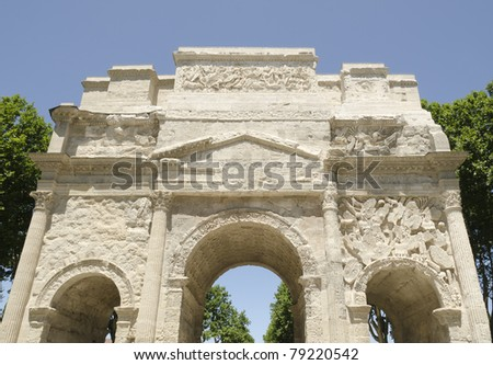 front of roman triumph arch in Orange city, France