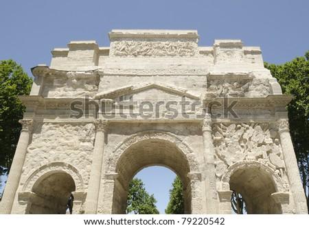 front of roman triumph arch in Orange city, France