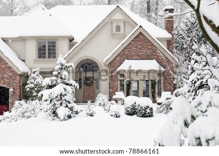 Front of suburban home in heavy snowfall