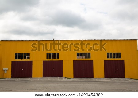 Front of the hangar for trucks. The big iron gate is closed. Four entrances.