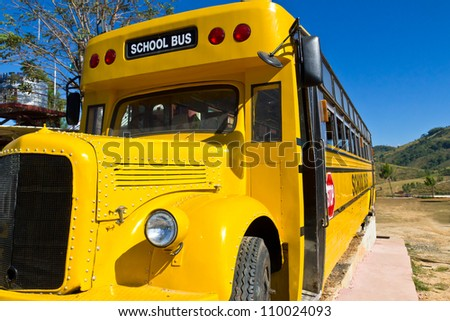Front of Yellow School Bus with Blue Sky