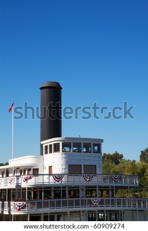 Front or Forward deck of old classic river boat with stove pipe and American flag