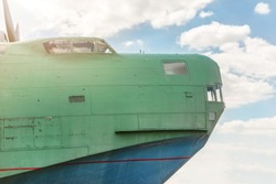 Front part of old amhibian plane against blue sky. Vintage anti-submarine military hydroplane aircraft . Toned