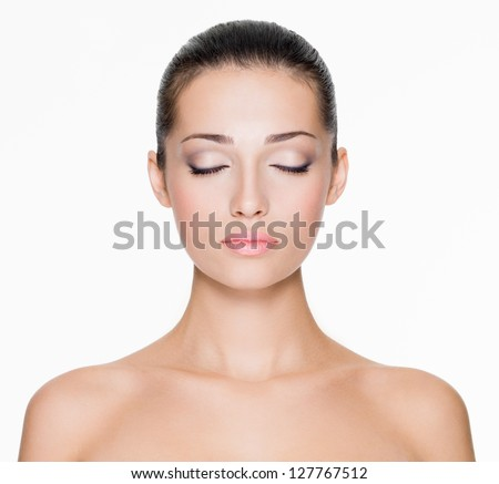 Front portrait of beautiful face with beautiful closed eyes - isolated on white