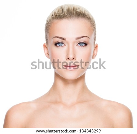 Stock Photo Front portrait of beautiful young woman with beautiful blue eyes and face - on white background