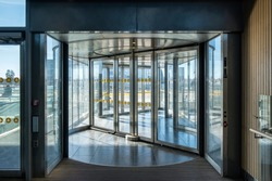 Front revolving transparent automatic rotate door in the airport
