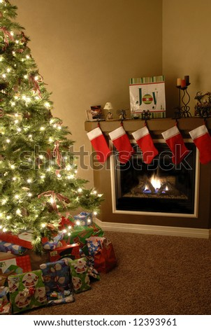 Front room decorated for christmas with christmas tree stockings and fireplace