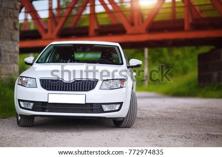 Front-side view of a car on nature background #772974835