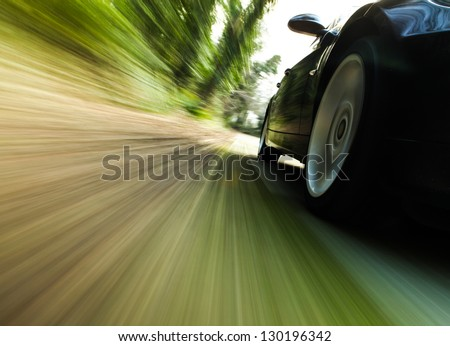 Shutterstock Front side view of black car driving fast.