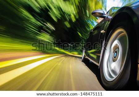 Front side view of black car with heavy blurred motion. #148475111