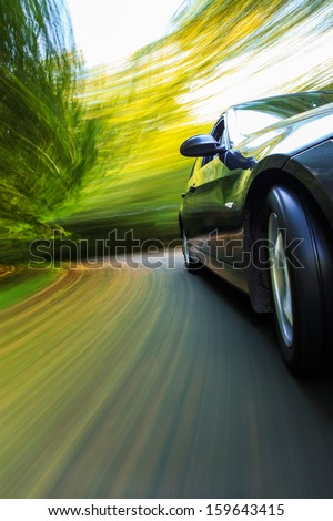 Front side view of black car with heavy blurred motion. #159643415