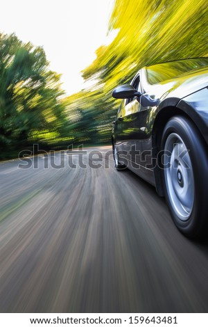 Front side view of black car with heavy blurred motion. #159643481