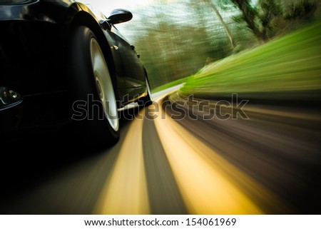 Front side view of speeding car. #154061969