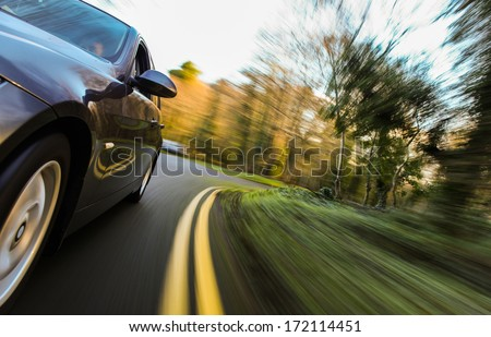 Front side view of speeding car