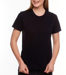 Front view - Advertising and T shirt design concept. Cropped portrait of stylish woman wearing black T-shirt and black jeans standing against white studio wall with copy space for your promotional