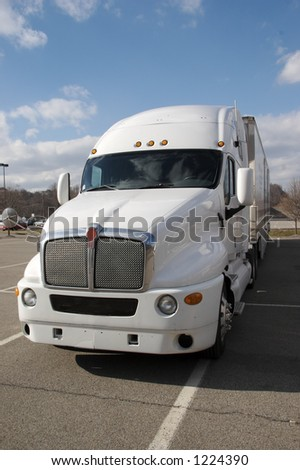 Front View at a slight angle of a white Semi Tractor Trailer Truck