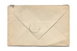 front view closeup of blank old aged closed letter paper envelope with torn edges and faded stamp print isolated on white background
