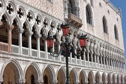 front view closeup of white Doge's Palace white tracery facade in Venice, Italy, Europe
