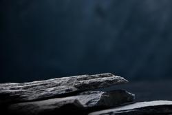 front view dark stone on blue background