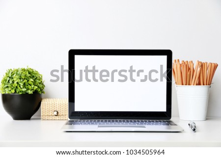 Front view minnal coppy space mock up with Laptop,Pencil,plants on business desk table modern in Office