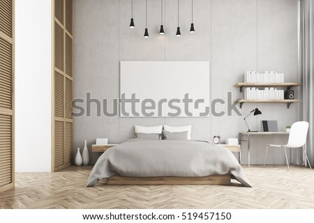 Front view of a bedroom with king size bed, a bookshelf, a table and a chair. Large horizontal poster is hanging above the bed. 3d rendering. Mock up.