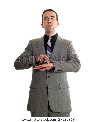 Front view of a businessman tapping a point on his hand as a step in performing the Emotional Freedom Technique, isolated against a white background