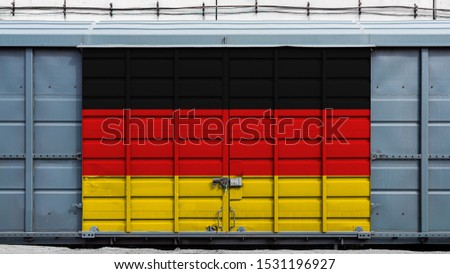 Front view of a container train freight car with a large metal lock with the national flag of Germany.The concept of export-import,transportation, national delivery of goods and rail transportation #1531196927