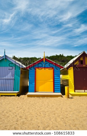 Front view of a couple of beach huts closed