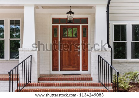 Front view of a front house, brown front door #1134249083