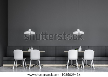 Front view of a gray wall cafe interior with gray sofas and white chairs. A close up. Concept of business lunch. 3d rendering mock up