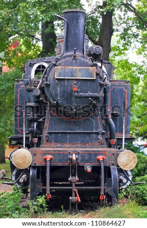 Front view of a historic steam train.