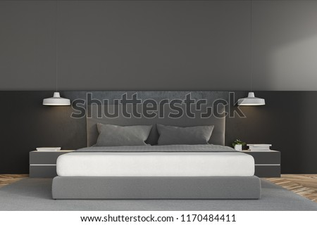 Front view of a luxury bedroom with grey walls, a concrete floor with a carpet, loft windows and a master bed with bedside tables. 3d rendering mock up