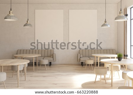 Front view of a modern cafe interior with two vertical posters on a concrete wall, wooden floor, round tables and chairs and beige sofas near tall windows. 3d rendering mock up