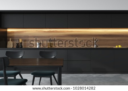 Front view of a panoramic black and wooden kitchen interior with dark gray countertops and a table with chairs. 3d rendering mock up