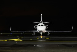 front view of a private plane on a parking lot