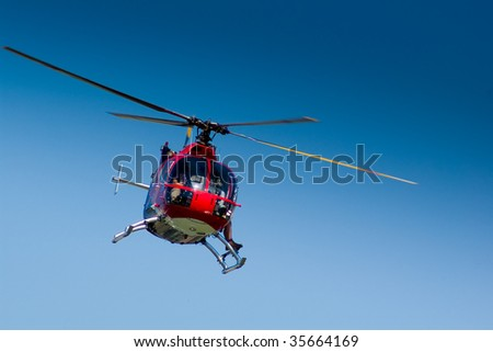 Front view of a red helicopter