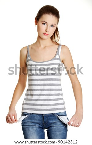 Front view of a sad young female caucasian teen taking out empty pockets, on white.