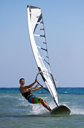 Front view of a windsurfer passing by