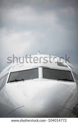 Front view of airplane in bad weather - selective focus