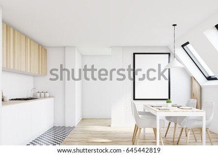 Front view of an attic kitchen with white walls, a long wooden table ...
