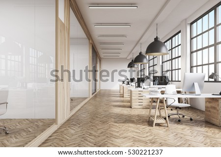 Shutterstock Front view of an office interior with a row of dark wood tables standing under large windows. Massive ceiling lamps. Computers. 3d rendering.