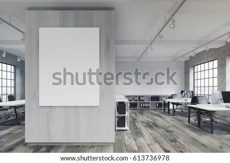 Front view of an office with a poster hanging on a gray wall, rows of tables with computers and wooden floor. 3d rendering. Mock up