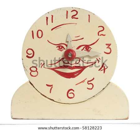 Front view of an old handcrafted wood toy clock isolated on white with clipping path. Hand painted white with red numerals and a face at the center. - stock photo