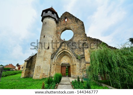 Front view of an old monastery of Gothic architecture in the heart of Transylvania./Front of a Gothic monastery in the heart of Transylvania./Front of a Gothic monastery from Transylvania.