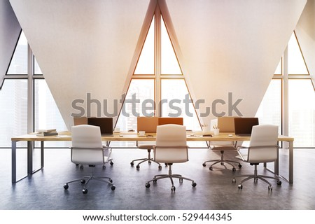 Front view of an open office with rost of tables with computers and three triangular windows. 3d rendering. Toned image #529444345