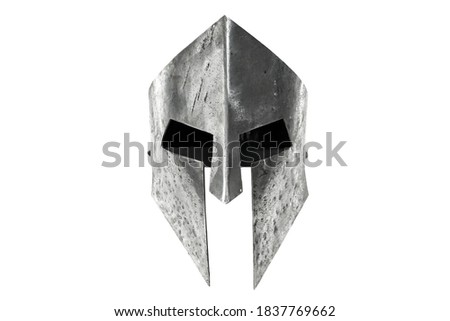Front view of ancient iron spartan helmet isolated on white studio background. Medieval armor, archeological souvenir from past times, metal tough head protective clothes. Stock photo ©