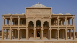 Front view of ancient mughal era carved sandstone tomb of Isa Khan Tarkhan II in UNESCO listed Makli necropolis, Thatta, Sindh, Pakistan