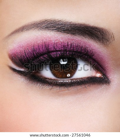 stock photo : Front view of beauty female eye with purple make-up