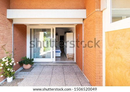 Front view of bedroom entrance with orange bricks. Nobody inside #1506520049